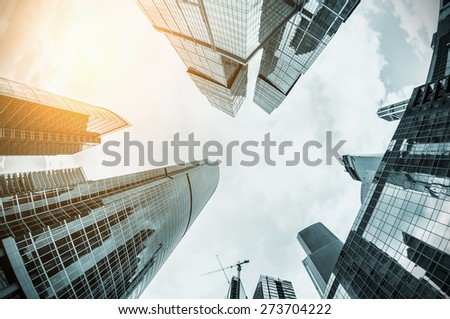 futuristic landscape of silhouettes of skyscrapers in the city. toning image. Focus on the tops of skyscrapers #273704222
