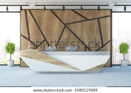 Futuristic reception desk with two computers in an office interior with wooden geometric pattern walls and potted trees. 3d rendering mock up