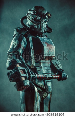 Stock Photo Futuristic soldier in steel armor with the cyber punk hummer.