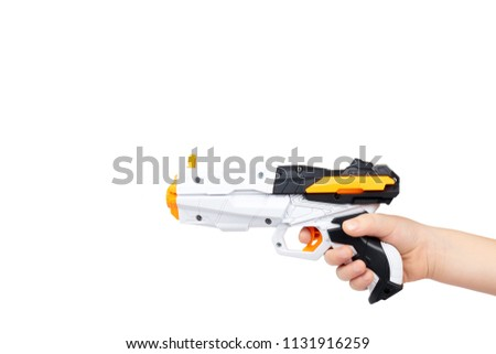 Futuristic toy gun with kid hand, isolated on white background. copy space template.