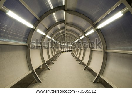 Futuristic tunnel with circular construction and glass windows