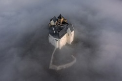 Fuzer, Hungary - Aerial view of the beautiful Castle of Fuzer standing out of the fog on an autumn morning. This castle has been located in the Zemplen Mountains