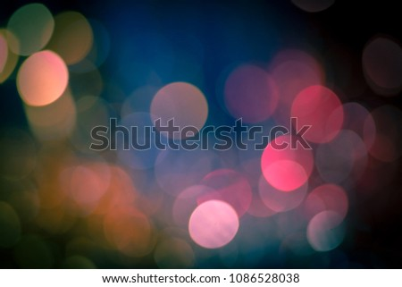 Fuzzy colorful bokeh background with blurred defocused lights in red and blue color