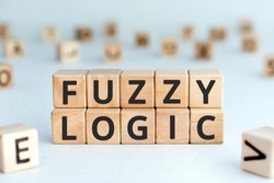 Fuzzy logic - phrase from wooden blocks with letters fuzzy logic concept, random letters around, white  background