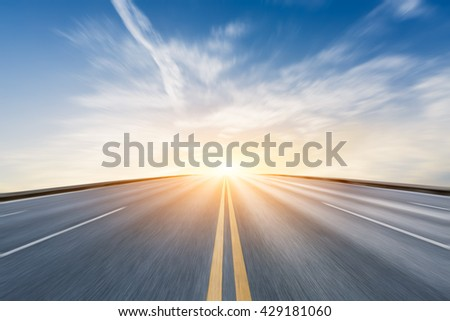 Fuzzy motion asphalt highway at sunset scene