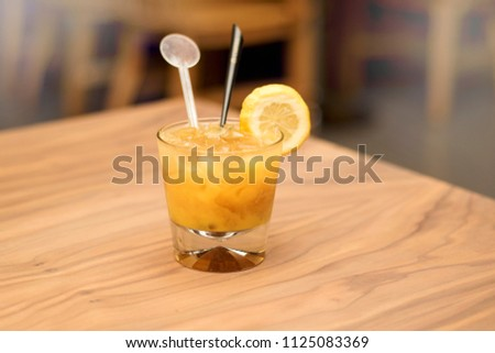 Fuzzy Navel Cocktail on wooden table
