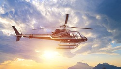 Fying helicopter in the setting sun