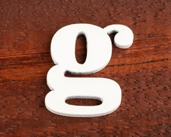 g - lowercase letter. Piece in wood
