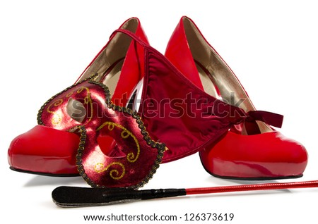 G-string,  riding crop and high heels close up, on white background.