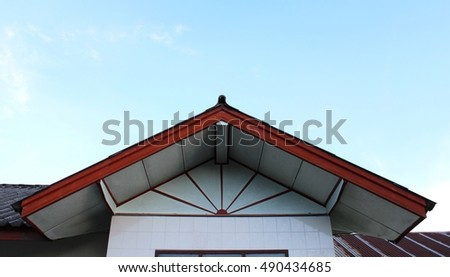 Gable with background is sky. #490434685