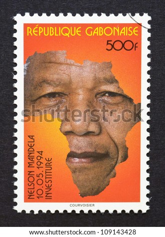 Gabonese Republic - CIRCA 1994: postage stamp printed in Gabonese Republic showing an image of Nelson Mandela with the african continent, circa 1994.