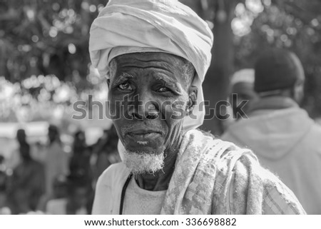 GABU, GUINEA-BISSAU - APRIL 13, 2014: Portrait of an African village chief heading to a council meeting