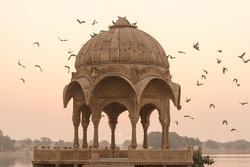 Gadi Sagar temple in Gadisar lake during sunrise. The temple and the lake located at Jaisalmer, Rajasthan, North India.