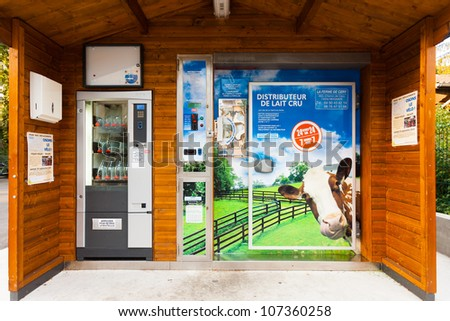 GAILLARD, FRANCE - SEPTEMBER 21, 2010:  A unique automated milk vending machine can dispense fresh milk 24 hours a day on September 21, 2010 in Gaillard, France