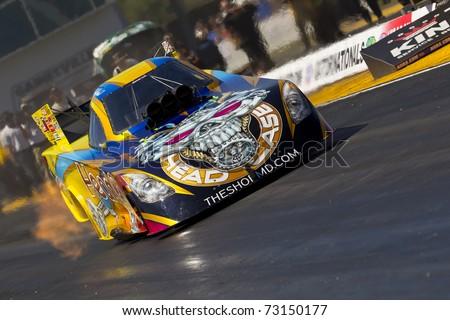 gainesville fl mar  driver jim head brings  funny car race car   track