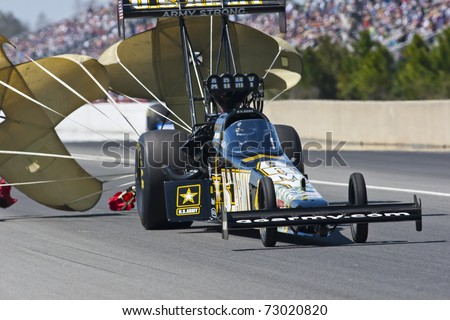 GAINESVILLE, FL - MAR 12: Driver, Tony Schumacher, slows his Top Fuel race car during the Tire Kingdom NHRA Gatornationals race at the Gainesville Speedway in Gainesville, FL on Mar 12, 2011.