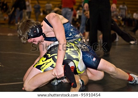 GAINESVILLE, GA, USA - FEB 11: Andy Leggett, the winner, holds an unidentified opponent in the 11-14 division of a wrestling tournament, February, 11, 2012, North Hall High School in Gainesville, GA.