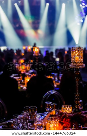 Gala Dinner Event Dinner Decor in dark room with stage lights and smoke
