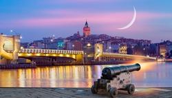 Galata Tower, Galata Bridge, Karakoy district and Golden Horn at night, istanbul - Turkey - Ramadan Concept - Ramadan kareem cannon with crescent
