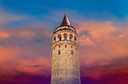 Galata tower isolated on cloudy sky background at sunrise - famous turkish landmark of Istanbul and Genoese tower in ancient history of Constantinople.