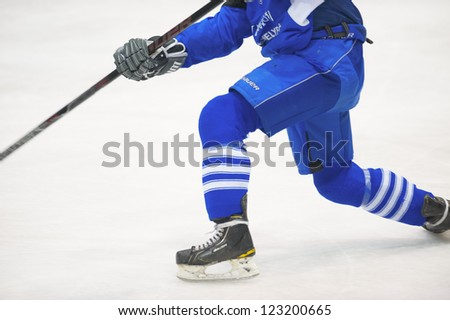 GALATI, ROMANIA - NOVEMBER 17: Unidentified player in action at hockey match with CSM Dunarea Galati (white) and CSS HSC Csikszereda (blue), Dovember 17, 2012 in Galati, Romania
