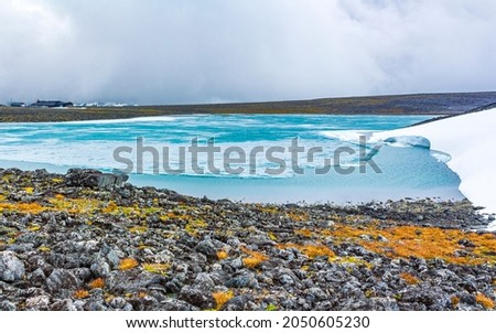 Galdhøpiggen snow-covered in summer in Jotunheimen Lom in Norway is the largest and highest mountain in Norway and Scandinavia with 2469 meters. Stock fotó ©