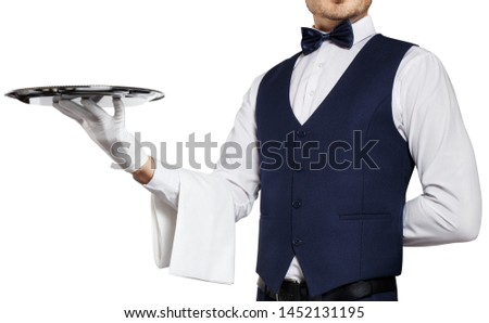 Gallant waiter holding a silver tray, isolated on white background