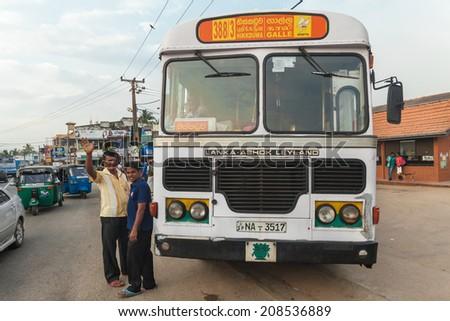 GALLE, SRI LANKA - FEBRUARY 22, 2014: Large public transport bus stopped on street. Buses are the Sri Lankan principal mode of public transport.