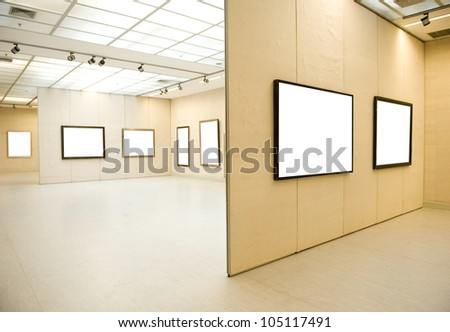 Gallery Interior with empty frame on wall - stock photo
