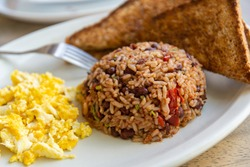 Gallopinto (black beans and rice) typical Costarican breakfast. Served with scrambled eggs and toast bread.