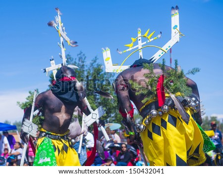 GALLUP , NEW MEXICO - AUGUST 10 :Apache dancers with traditional costume participates at the 92 annual Inter-tribal ceremonial parade on August 10 , 2013 in Gallup New-Mexico