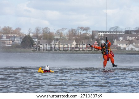 GALWAY, IRELAND - APRIL 12: Irish Coast Guard crew display a water rescue training over Lough Atalia as part of the annual Galway Watersports Show, on April 12, 2015 in Galway, Ireland.
