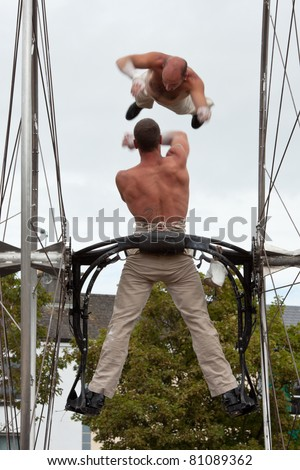 GALWAY, IRELAND - JULY 14: French acrobats and circus artists Les Philbulistes M.Bourdon and S.Bruas performs at annual Galway Arts Festival on July 14, 2011 in Galway, Ireland.