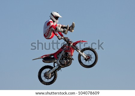 GALWAY, IRELAND - MAY 26: Dave Wiggins freestyle motocross rider jumps through the air during The  Extreme Stunt Show on May 26, 2012 in Galway, Ireland
