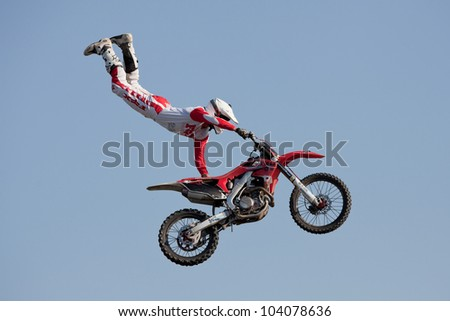 GALWAY, IRELAND - MAY 26: Dave Wiggins freestyle motocross rider jumps through the air during The  Extreme Stunt Show on May 26, 2012 in Galway, Ireland - stock photo