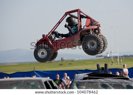 GALWAY, IRELAND - MAY 26:  Unidentified freestyle buggy  rider jumps through the air during The  Extreme Stunt Show on May 26, 2012 in Galway, Ireland
