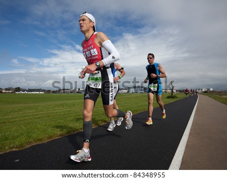 GALWAY, IRELAND - SEPT 4: Mark Samuels (477) competes at first Edition of Galway Iron Man  Triathlon on September 4, 2011 in Galway, Ireland