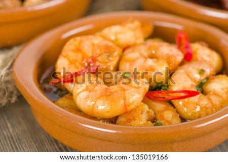 Gambas Pil Pil (Sizzling prawns with chili and garlic). Traditional Spanish tapas dish.