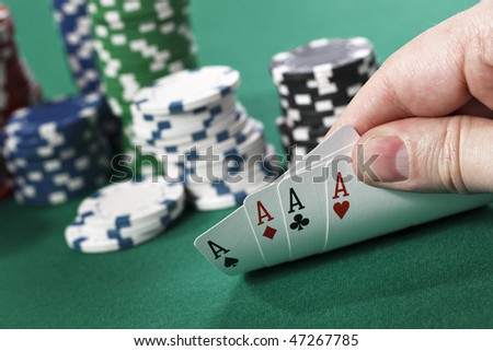 Gambler checking at his four aces