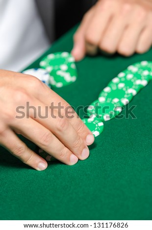 Gambler puts the chips on the table. Challenge to the casino