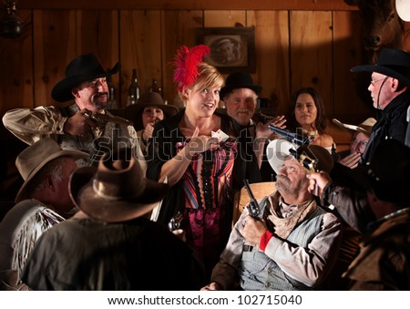 Gamblers hold up cheating prostitute showing ace of hearts - stock photo