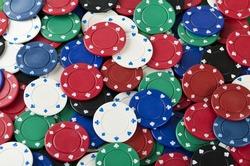 Gambling background with poker chips. Full frame.