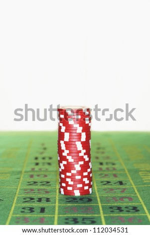Gambling chips on roulette table