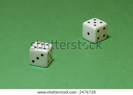 Gambling dices on a casino table background