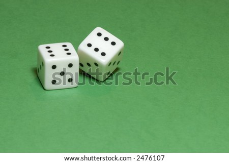 Gambling dices on green casino table background (also available on white or black backgrounds)
