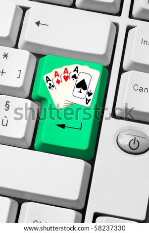 gambling on internet - casino on line - keyboard with aces poker on green enter key