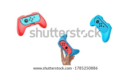 Game console on hand isolated white background. Red Blue Gaming console. Wireless game controller Foto stock ©
