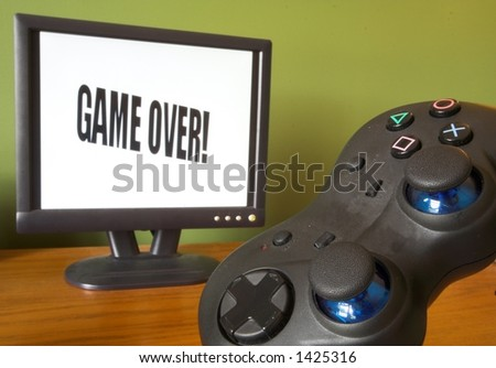 game controller and screen showing game over