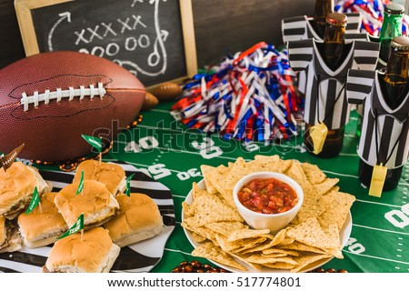 Game day football party table with beer, chips and salsa. #517774801