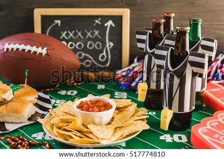 Game day football party table with beer, chips and salsa. #517774810